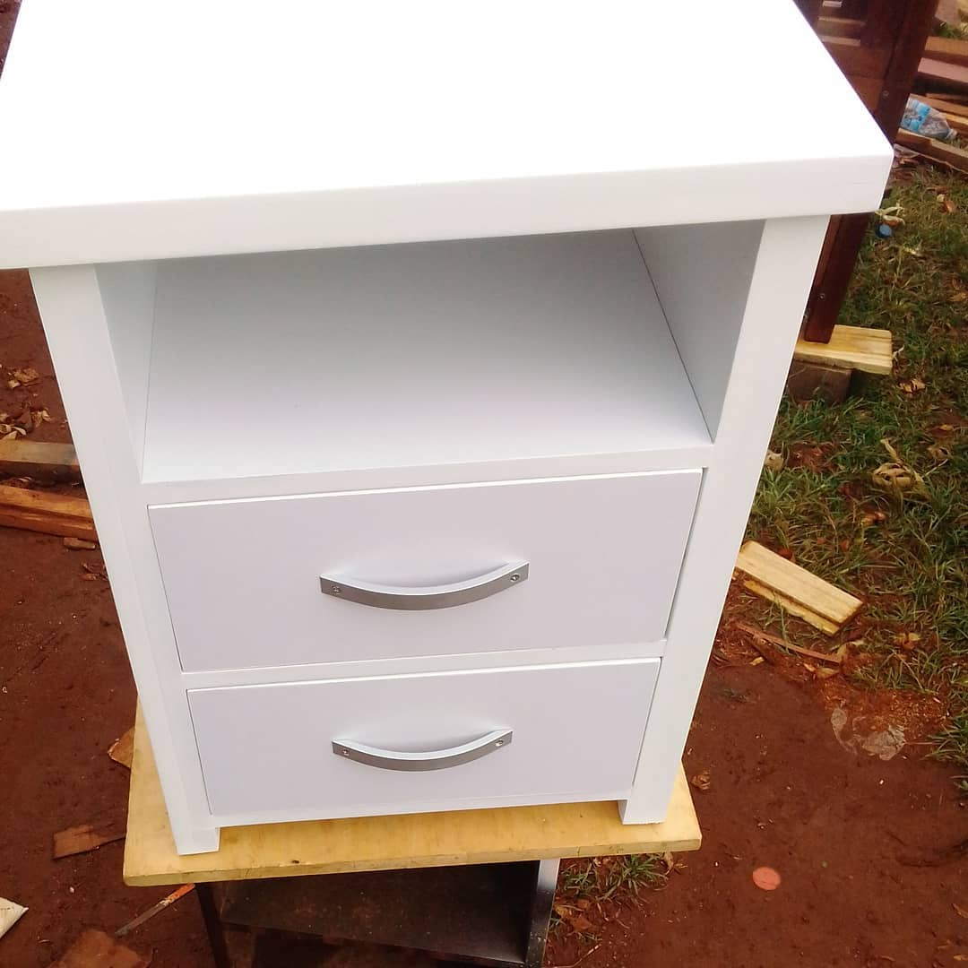 white wooden bed side table